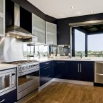 Dark blue kitchen with silver appliances
