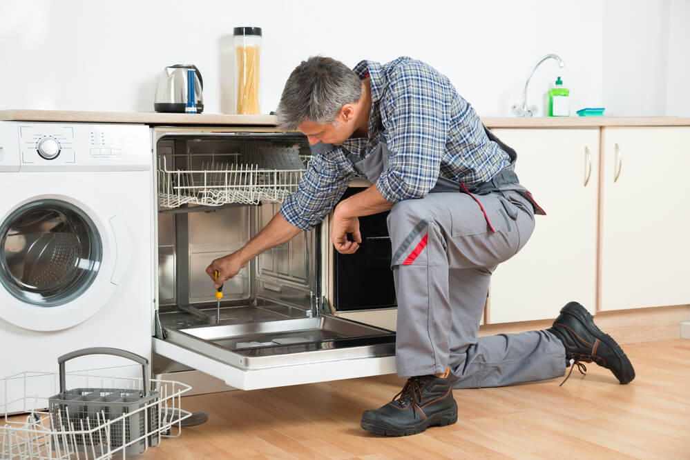 Dishwasher being repaired